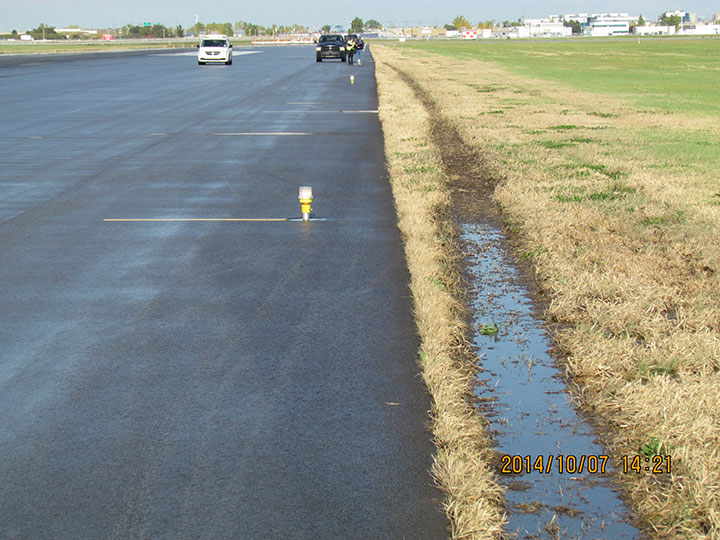 Photo of tread marks made in the dirt off the runway by exterior wheels of left bogy.
