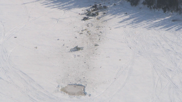 Still of an aircraft accident site, from the collisions with land and water video